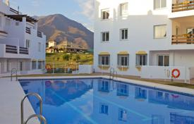 Apartments with pools for sale in Estepona. Comfortable apartment with a terrace and a sea view in a residential complex with gardens and swimming pools, Estepona, Spain