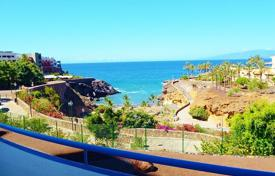 Cheap apartments with pools for sale in Adeje. Furnished apartments with terrace and views of the ocean, in a residence with a swimming pool, on the beach front in Playa Paraiso, Tenerife