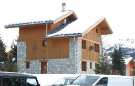 Luxury chalets for sale in Alps. Comfortable chalet with a terrace and a mezzanine, located on the ski slope, next to the ski lift, Meribel, Alpes, France
