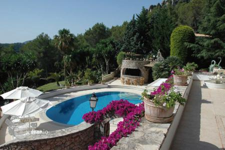 Luxury houses for sale in Majorca (Mallorca). Villa with fireplaces, sea view terraces, a pool, a garden, a billiard room, and a guest house, Pollensa, Mallorca, Spain