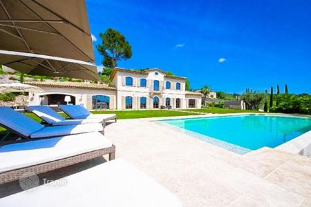 Luxury houses with pools for sale in France. Villa with a fireplace, a cinema and a large park, in a gated residence, Mougins, France