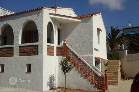 Coastal houses for sale in Costa Blanca. Two-storey villa with garden only 20 meters from the sea in Calp, area Carrió