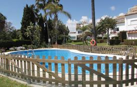 Townhouses for sale in Costa del Sol. Cozy townhouse with a terrace and a sea view in a residential complex with a pool and a garden, Estepona, Spain