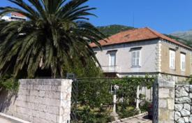 6 bedroom houses for sale in Croatia. Two-level villa with a garden, a garage and a pier on the first line of the sea near Dubrovnik, Dalmatia, Croatia