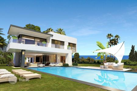 4 bedroom houses by the sea for sale in Southern Europe. Exclusive villa with panoramic view at the sea, garage and pool, Malaga, Spain