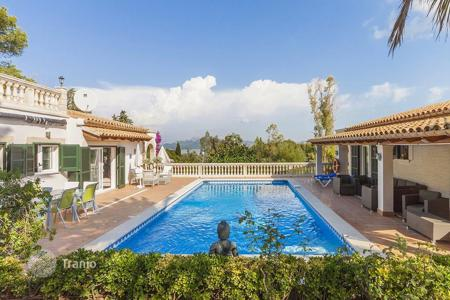 Houses with pools for sale in Alcudia. Furnished villa near Alcudia, Mallorca, Spain. Guest house, panoramic views of the bay and the mountains, terraces. High rental potential!