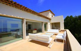 Houses with pools for sale in Vallauris. Modern house with a garden, a pool, a garage and a sea view, Vallauris, France