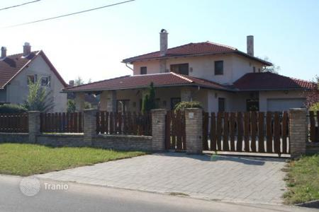 Houses for sale in Pest. Comfortable Mediterranean style house on the shores of lake in Veresegyhaz, Hungary