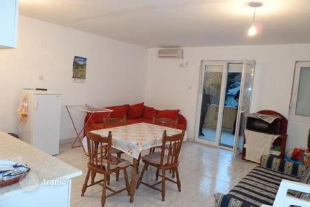 Coastal property for sale in Budva. Two-bedroom apartment in Petrovac, Montenegro