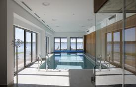 Apartments with pools for sale in Baltics. Comfortable apartments in a modern complex on the lake in Adazi, a suburb of Riga