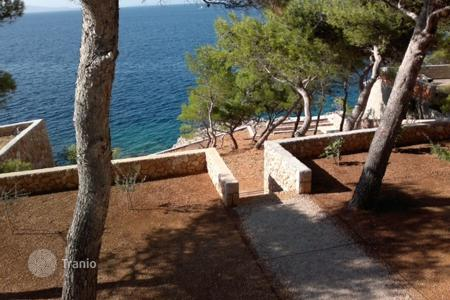 Residential for sale in Hvar. House under construction — first line from the sea