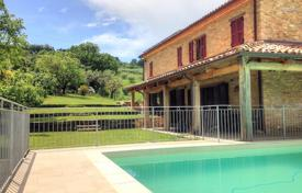 Houses with pools for sale in Marche. Beautiful villa with a terrace, a pool and a garden near Cupramontana, Italy