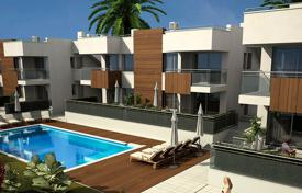 Apartments with pools for sale in Murcia. Apartment with private garden in first line of the beach in Mazarrón