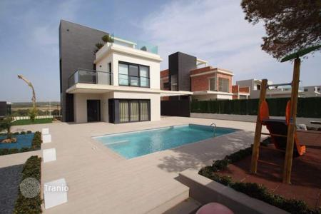 Houses with pools for sale in Dehesa de Campoamor. 4 bedroom villa with private pool, children 's playground, 500 sqm plot and BBQ, furnished, in Campoamor