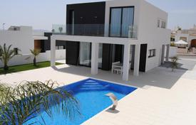 Houses with pools for sale in La Marina. Two-level new villa with a pool in La Marina, Alicante, Spain