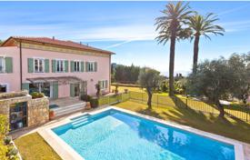 Houses for sale in France. Two-storey villa with a pool, a terrace, a garden and panoramic sea views, Nice, France