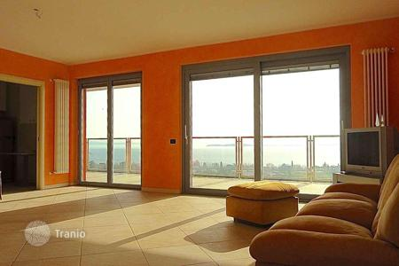 Apartments for sale in Moniga del Garda. Lake view apartment in residence with pool