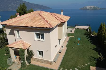 Houses with pools for sale in Attica. Villa with private beach in Attica