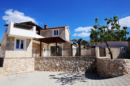 3 bedroom houses for sale in Croatia. The villa is in the traditional Dalmatian style with sea view in Stivasnitse, Rogoznica, Croatia