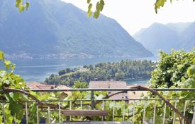 Houses for sale in Ossuccio. Refurbished historic building with a view of Lake Como, Ossuccio, Italy
