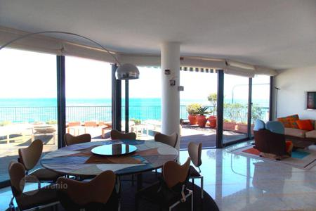 Luxury 2 bedroom apartments for sale in Italy. Penthouse with a roof-top terrace and a jacuzzi, in a renovated beachfront residence, Laigueglia, Italy