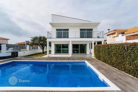 5 bedroom houses for sale in Cascais. New villa with garden and pool in a gated community in a quiet area of Birre, Cascais, Portugal
