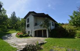 Property for sale in Orino. Spacious villa with a veranda, two balconies and a huge garden, Orino, Lombardy, Italy