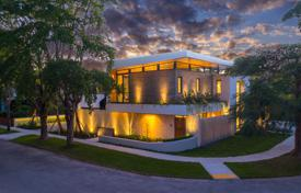 Houses with pools for sale in North America. New designer house with a pool and a garage in Miami, Florida