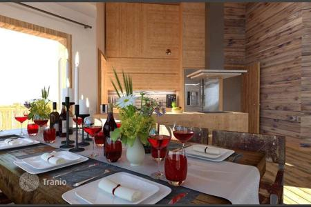New homes for sale in French Alps. Two-bedroom apartment with a terrace in a new complex in the ski resort of Morzine, Haute-Savoie, France