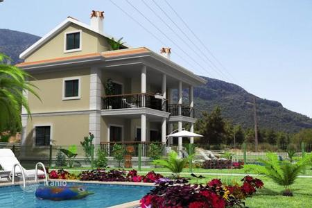4 bedroom off-plan houses for sale overseas. Villa with a view of mountains and sea in Fethiye