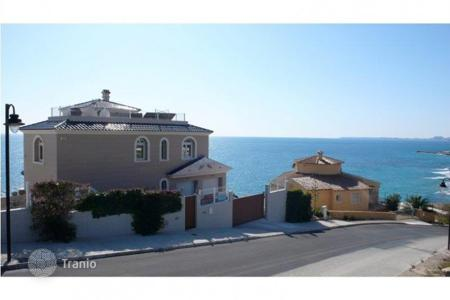 Houses for sale in El Campello. Villa of 4 bedrooms in front line beach with private pool in El Campello