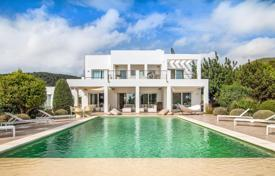 Luxury villas and houses for rent with swimming pools in Ibiza. Bright villa with a pool, a tennis court, a guest apartment and sea views, Ibiza, Spain
