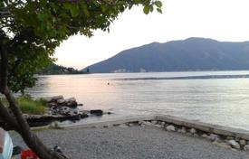 Development land for sale in Kotor (city). Old buildings on the waterfront in the beautiful Risan bay, the municipality of Kotor