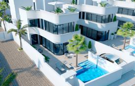 Houses with pools for sale in La Marina. Three-level villa with a pool in La Marina, Alicante, Spain