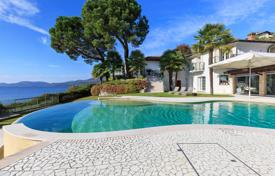 Luxury 2 bedroom houses for sale in Italy. Maggiore lake. Luxury waterfront villa with swimming pool and private dock.