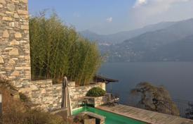 Luxury houses with pools for sale in Lombardy. Comfortable villa with a private plot, a swimming pool, a terrace and a lake view, Carate Urio, Italy