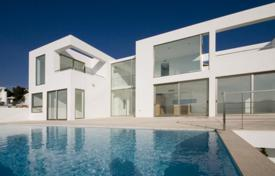 Luxury 3 bedroom houses for sale in Ibiza. Stylish seaview villa with an infinity pool in a luxury gated urbanisation, Ibiza, Spain
