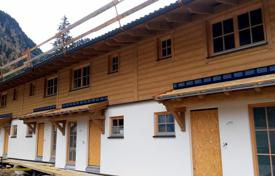 Residential for sale in Austria. Half of the house with a garden near the mountain lake, Kaprun